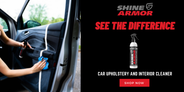 Woman using Shine Armor upholstery cleaner on a white car.