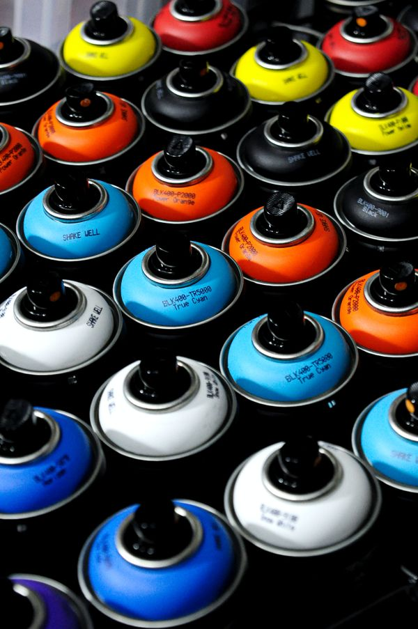 Rows of different colored spray paint cans for cars.