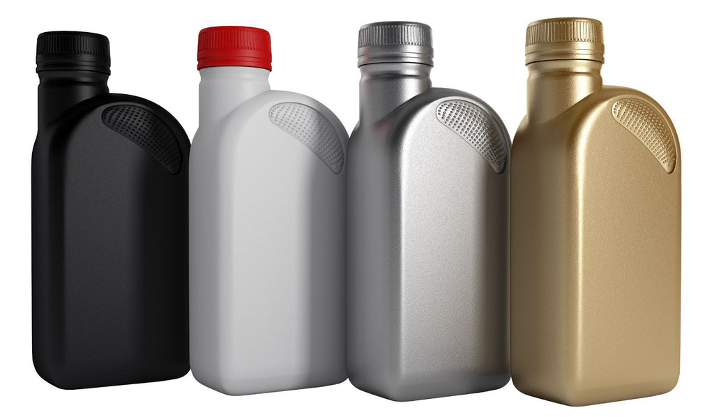 Four quarts of different types of oil for cars.