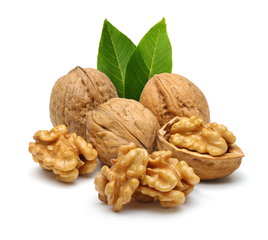 Walnuts in shell and some out of shell nuts