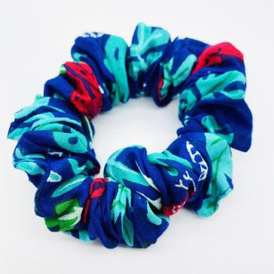 Emma's scrunchie jungle accessory The Extra Smile jungle print