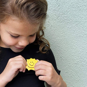 The Sun pin accessory The Extra Smile
