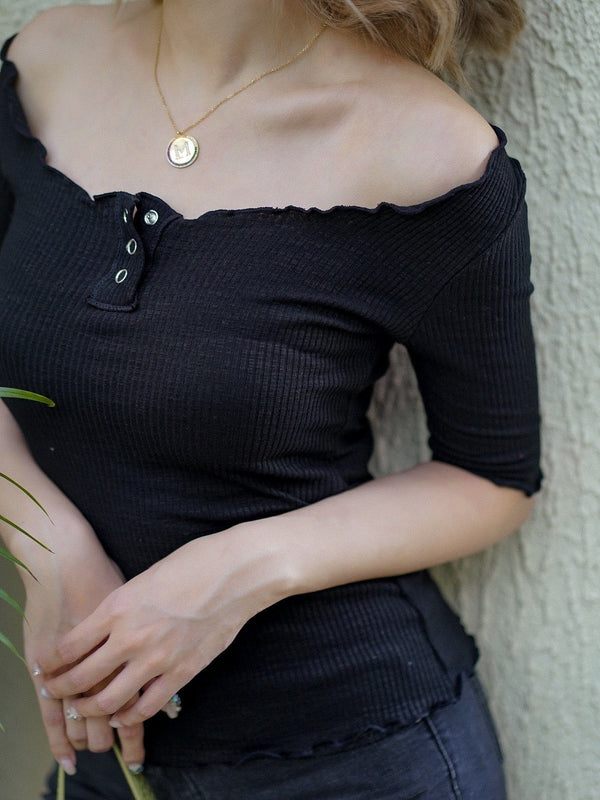 Skinny Top With Ruffle Button Details In Black