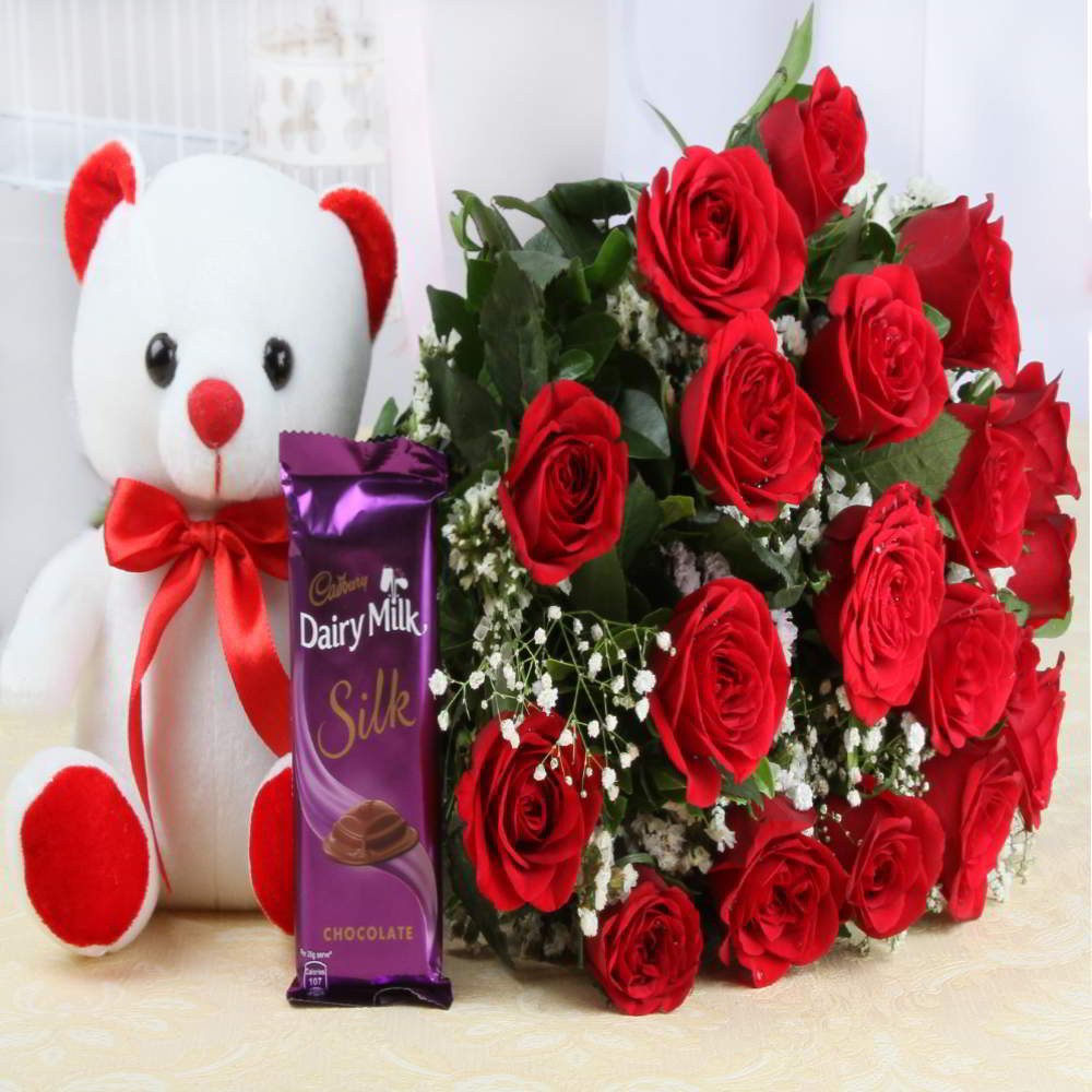 Bouquet of roses and cute teddy bear with dairy milk silk chocolate izmirmasajfo