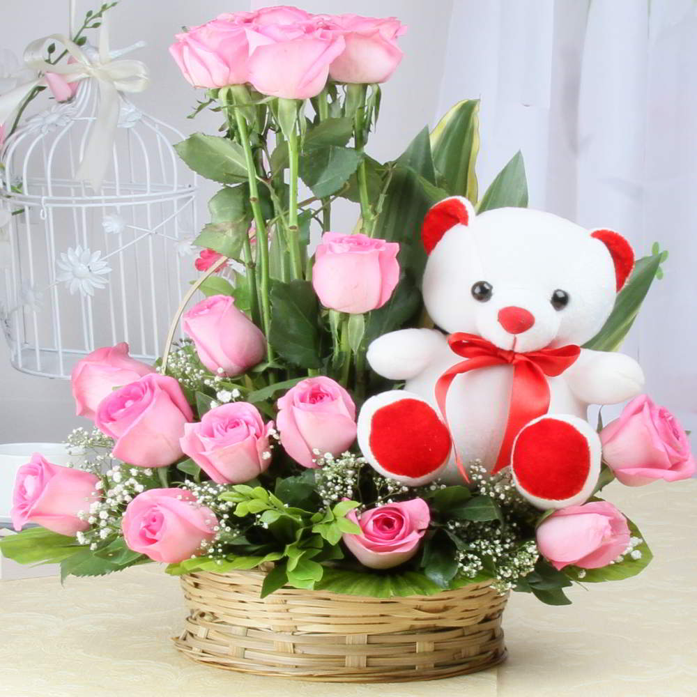 basket arrangement of pink roses with cute teddy bear