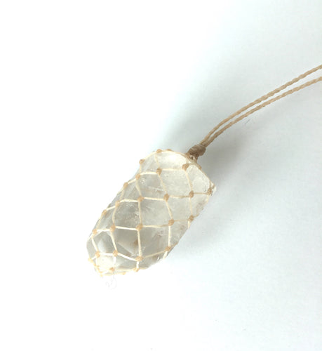 medium polished quartz crystal - off-white cord