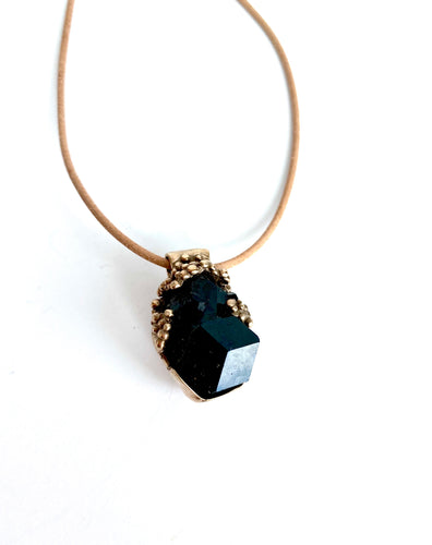 Black tourmaline cluster in bronze setting