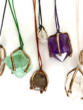 Green fluorite crystal caged in bronze