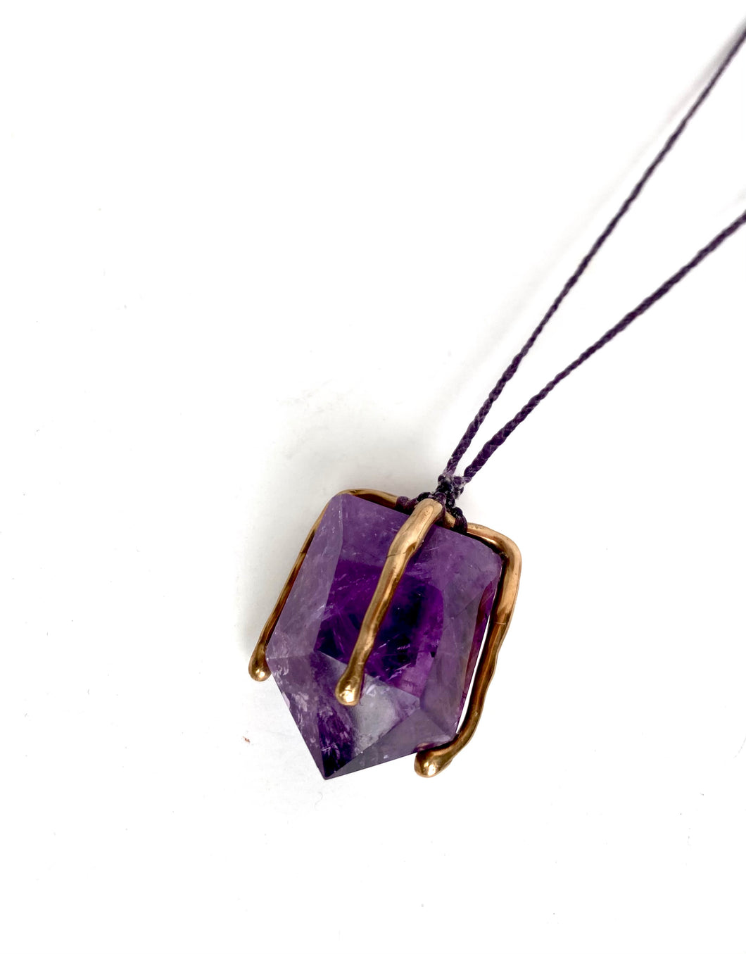 Amethyst crystal caged in bronze