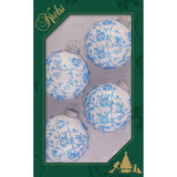 four white glass ornaments with blue glitter lace