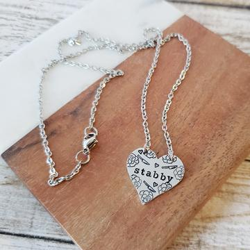 stabby heart necklace