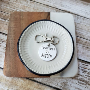 hand stamped child's backpack tag