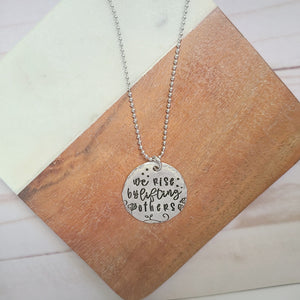 We Rise By Lifting Others Round Necklace