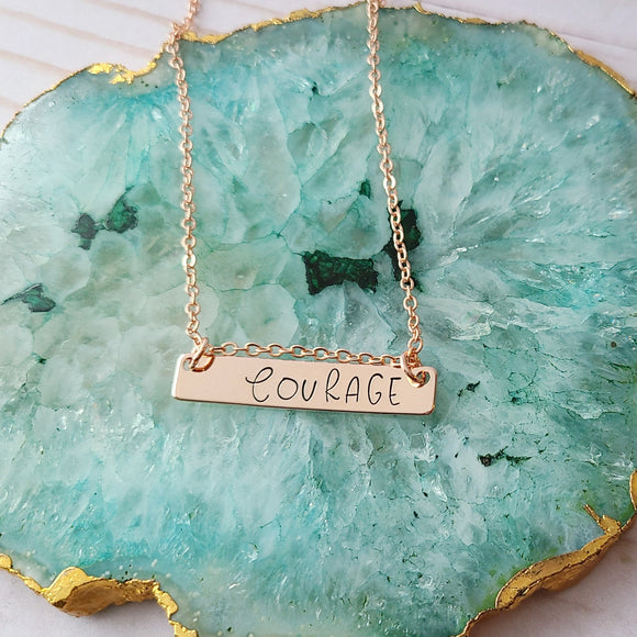 Rose Gold Plated Hand Stamped Necklace with the Word Courage Stamped on It