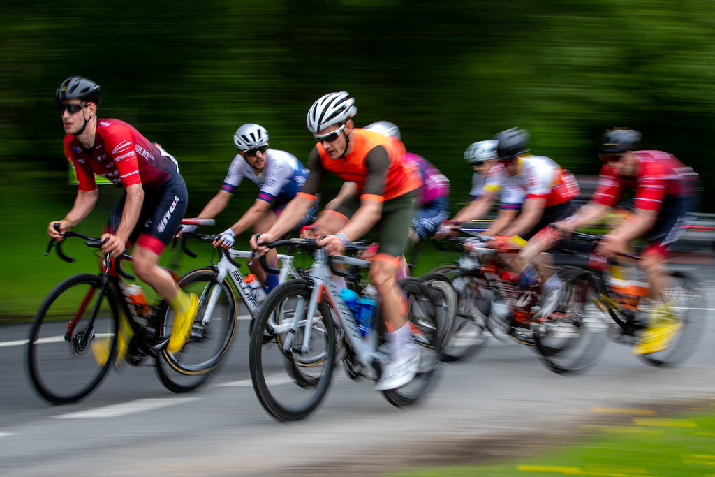 Racing cyclists, image blurred to connote speed