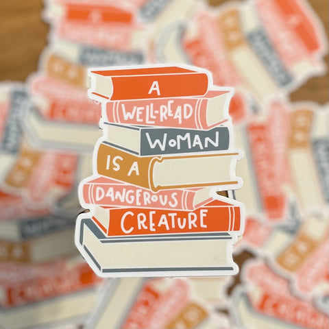 A well-read woman is a dangerous creature - book lover sticker by Kelly Design Company