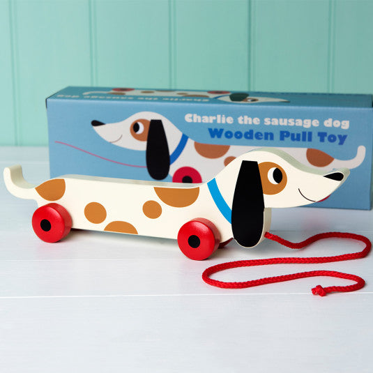 sausage dog wooden pull along toy