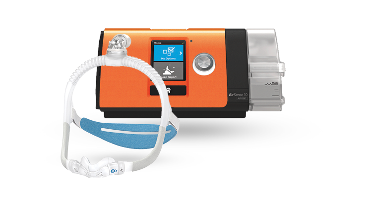 The ResMed AirSense 10 with the Lofta orange faceplate next to a Resmed AirFit mask.