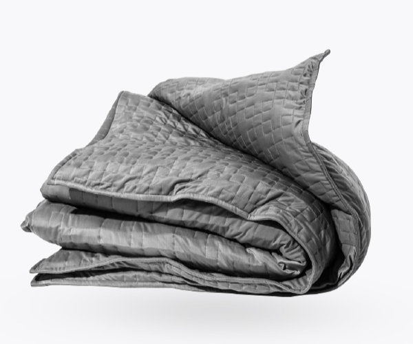 Grey Gravity blanket folded over and looking very inviting and comfortable.