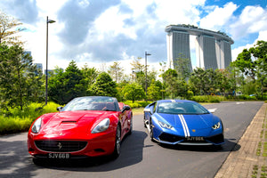 A red Porsche and Blue Lamborghini