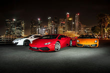 Three luxury cars
