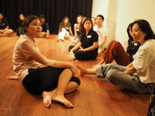 Group of people on floor of acting studio