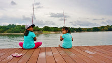 Two young girls fishing