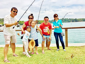 Four adults and two children with fishing rods