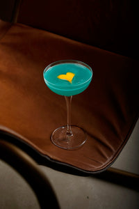 Small blue cocktail with yellow heart on top