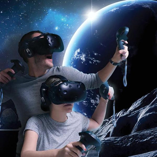 Man and girl in VR gear, playing a game set on the moon with the earth in the background