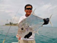 Man holding up a large fish