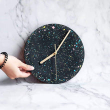 Clock with galaxy pattern