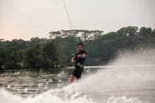 A man wakeboarding