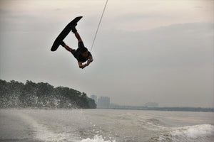 A man backflipping on a wakeboard