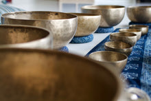 Close up of many singing bowls