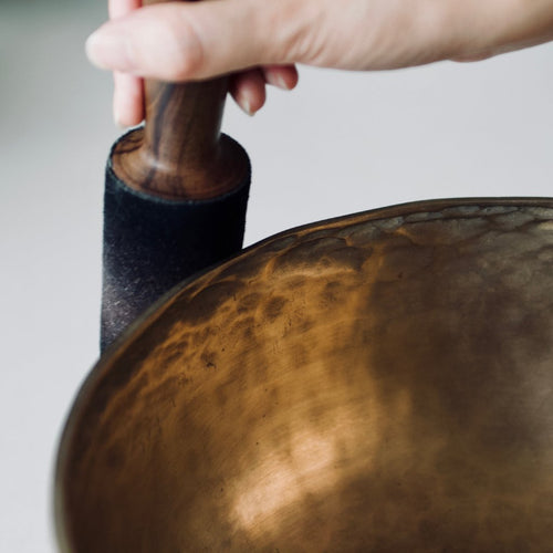 Close up of person playing a singing bowl