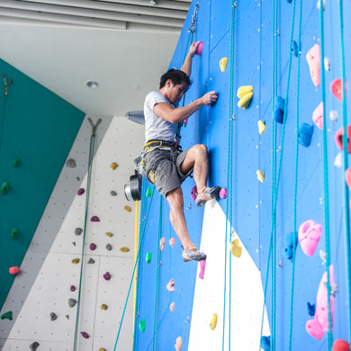 Man on a rock climbing wall