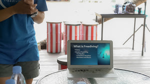 Man with computer with presentation about freediving