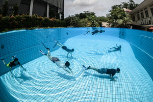 Many people diving in swimming pool