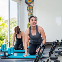 Woman on a pilates machine