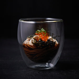 A glass with somen noodles and sauce inside