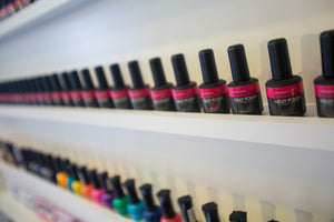 Close up of a shelf of nail polish