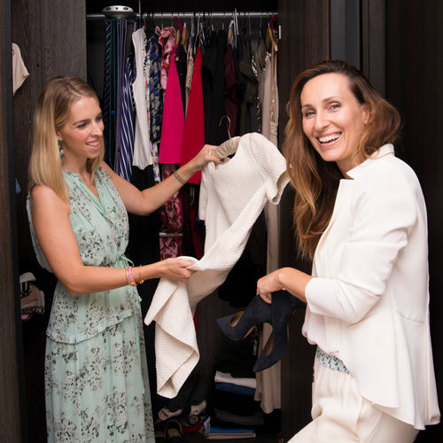 Two women looking at clothes