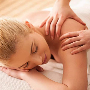Blonde woman getting a back massage