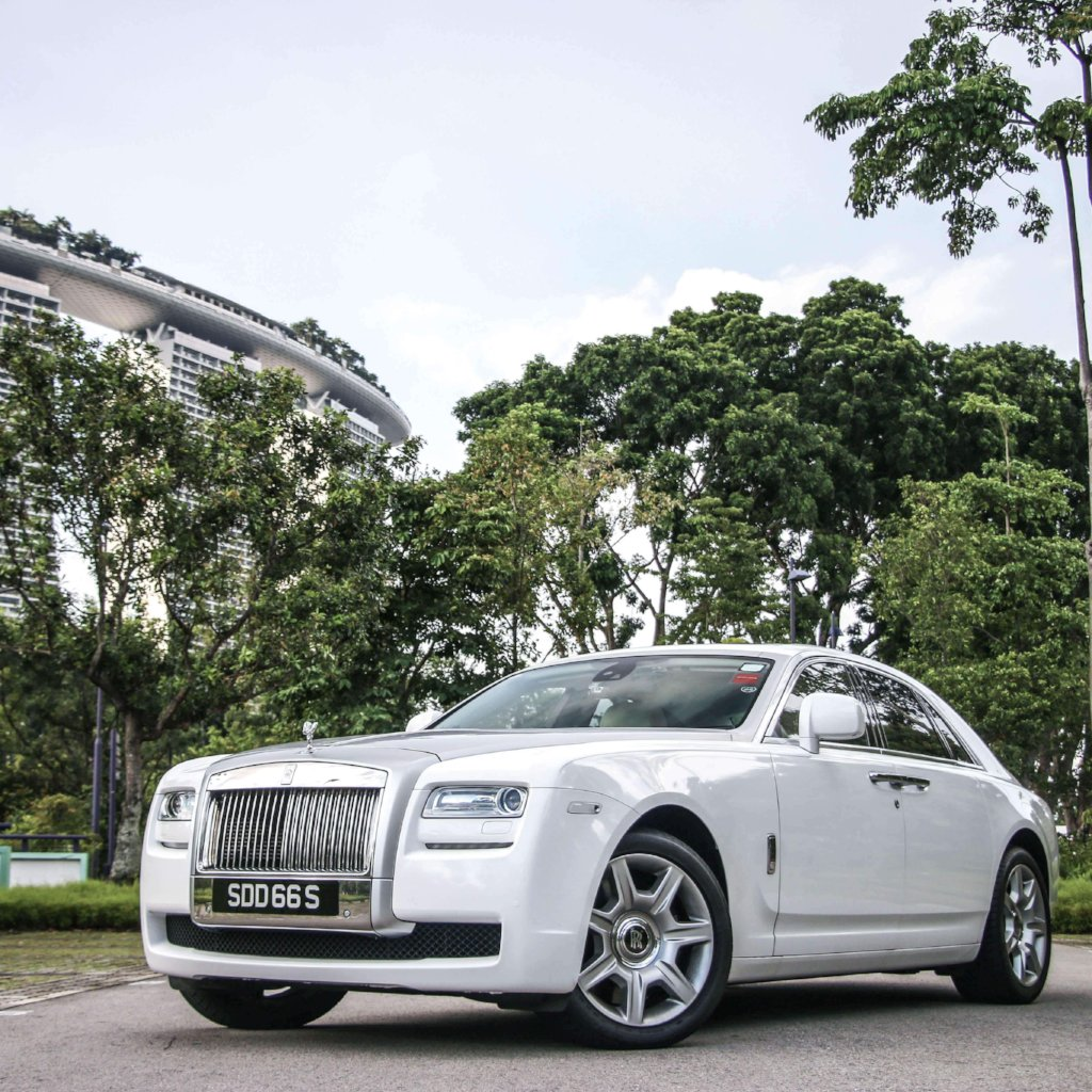 White Rolls Royce with Marina Bay Sands in background