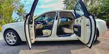 White Rolls Royce with doors open