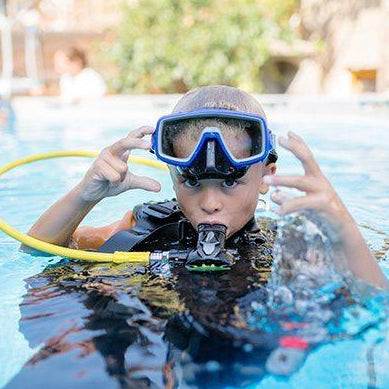 A scuba diver in a swimming pool