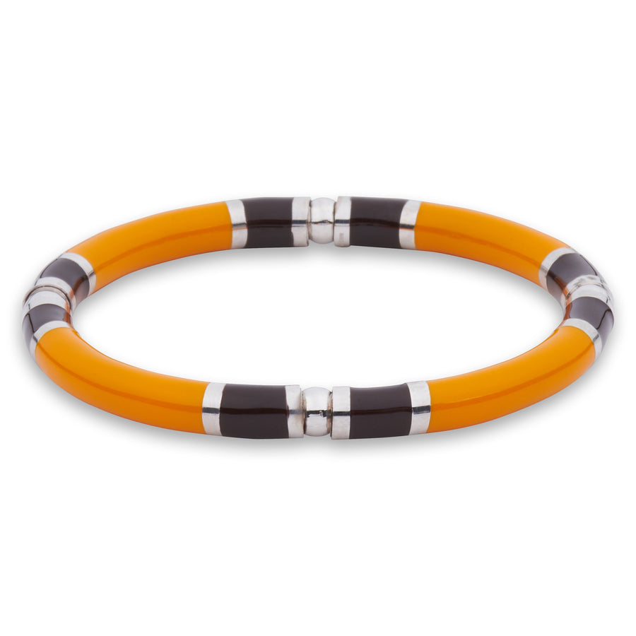 Xtinctio -  Stretch Bangle Hand made in Italy by a 3rd generation Goldsmith.  Eco conscious White Bronze and orange enamel. Imbued with the spirit of the endangered Orangutan