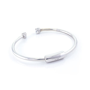 Xtinctio -Xtinctio Bracelet Made in Italy Recycled Sterling silver Love XX bracelet eco conscious, chic and comfortable representing your commitment to protecting these critically endangered species and their habitats   An  X  at each end of the bangle and bead with the  word Love debossed  on it.
