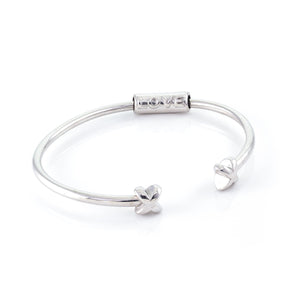 Xtinctio Bracelet Made in Italy Recycled Sterling silver Love XX bracelet eco conscious, chic and comfortable representing your commitment to protecting these critically endangered species and their habitats   An  X  at each end of the bangle and bead with the  word Love debossed  on it.